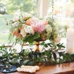centerpiece arrangement with peach and pink flowers