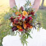 Autumn Wedding Bouquet with nandina, papaya callas, coffee break roses, Impulse roses and eucalyptus.