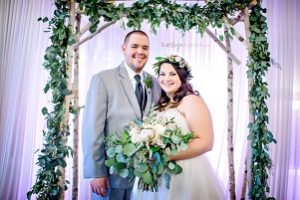 birch arbor, green garland, blush wedding flowers