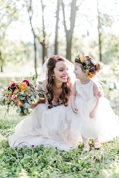 Bride with her flower girl, flower girl crown, bridal bouquet