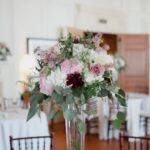 tall centerpiece with peonies and roses