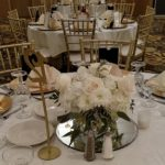 Cube vase centerpiece with ivory roses and hydrangeas