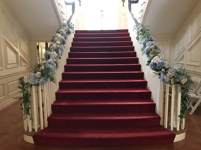 Floral staircase at Allerton Mansion