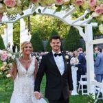 Outdoor wedding floral pergola