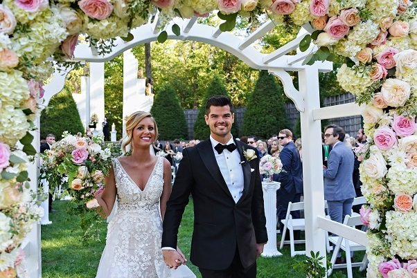 Outdoor wedding floral pergola