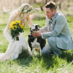 Sunflower cascading bridal bouquet, bride and groom with dog