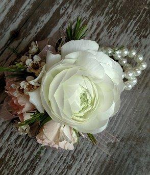 white ranunculus wrist corsage