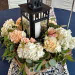 Lantern centerpiece, flowers in wood box
