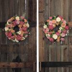 Floral wreaths on barn doors