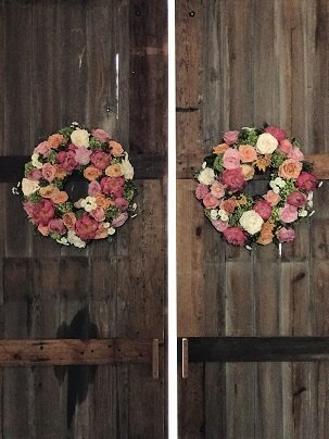 Floral wreaths on barn doors