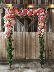 Pergola covered with peonies and roses.