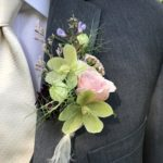 Boutonniere with spray rose and helleborus