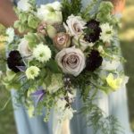 garden style bouquet with blush, cream and burgundy blooms