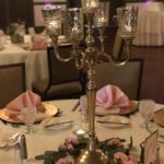 reception centerpiece with gold candelabra