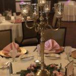 reception centerpiece with gold candelabra