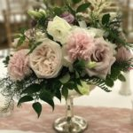 Mercury compote centerpiece with blush and mauve blooms