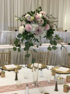 Tall gold stand centerpiece arrangement with blush roses