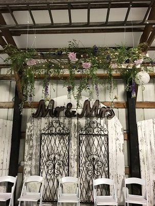 Wedding backdrop with decorated hanging ladder
