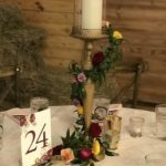 Candle holder with floral garland