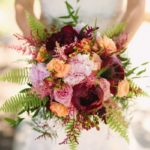 wedding bouquet, burgundy peonies, peach ranunculus, pink roses