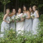 White wedding bouquets, blue gray bridesmaid dresses