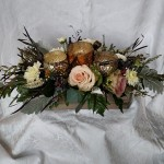 blush flowers in a wooden box with votives
