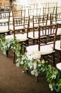aisle decor with garland and blooms