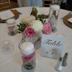 cylinder vases, submerged flowers, candle arrangements
