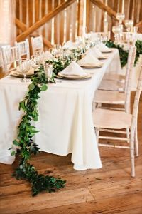 neutral table setting, green garland