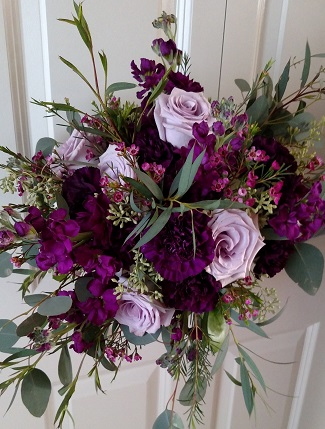 Coming in second place was plum with six of our central Illinois brides choosing plum colored blooms for their bridal bouquets.