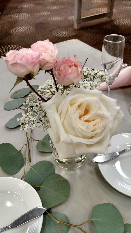 Rose centerpiece, reception decor, flowers in bottles