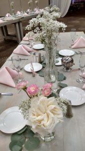 reception decor, bottles of flowers