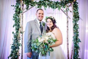 White birch wedding arbor, garland, bride and groom, wedding day decor