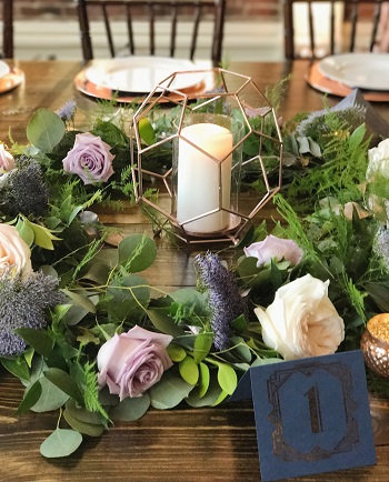 reception decor, garland with blooms, table centerpiece arrangement