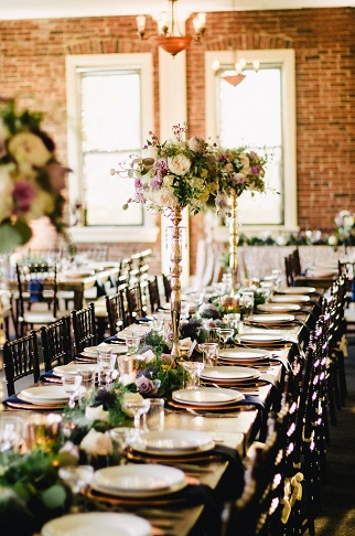 Tall centerpiece arrangements, wedding garland, reception table decor