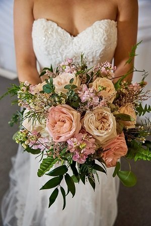 Bridal bouquet we used a combination of pastel garden roses along with stock and mixed greens for her bridal bouquet and wedding arbor backdrop junglespirit Choice Image