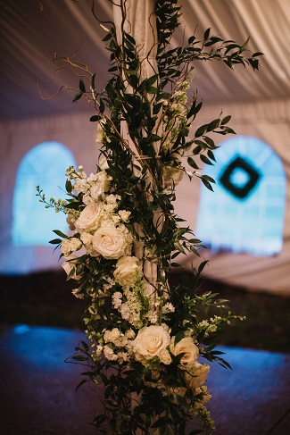 tent pole decor, floral pillar, reception tent decor