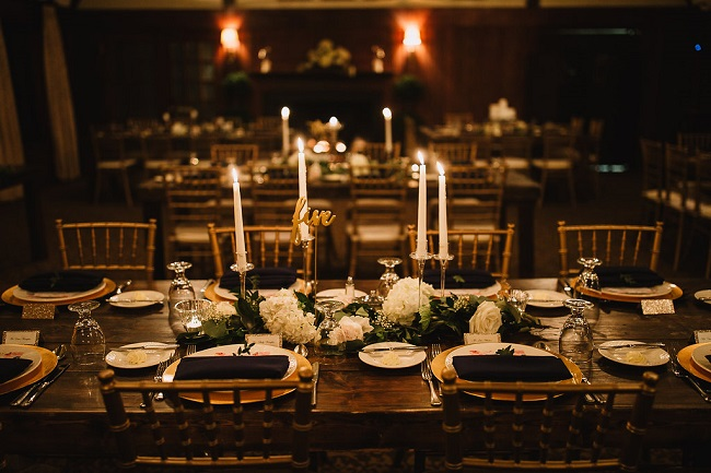 reception table decor, candlelight, garlands and white blooms