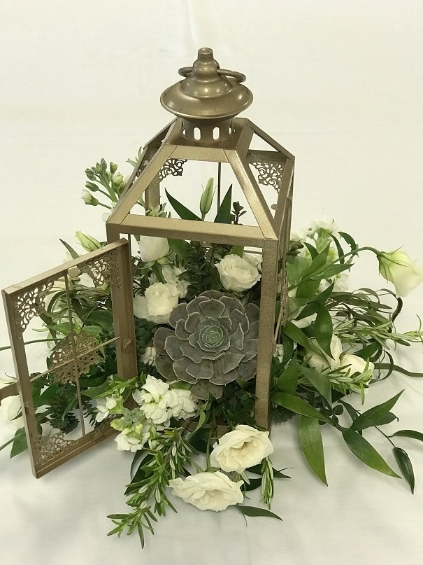 Lantern filled with flowers & succulent