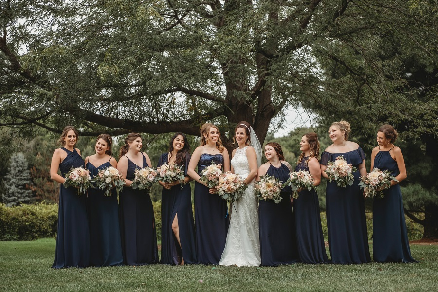navy bridesmaid dresses, blush bridal bouquets